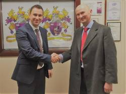David Fisher, Head of The Cavendish School, receives £500 prize draw award from EdufundUK's Communications Director, Gareth Mottram.